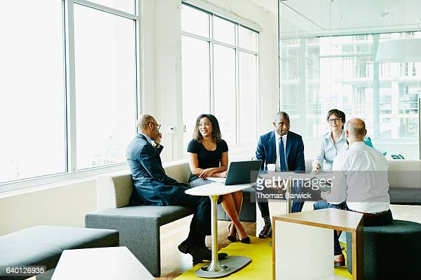 Businesspeople in discussion during meeting