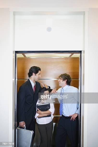 Businesspeople in elevator