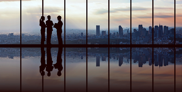 Businesspeople in front of urban cityscape. 1029147444