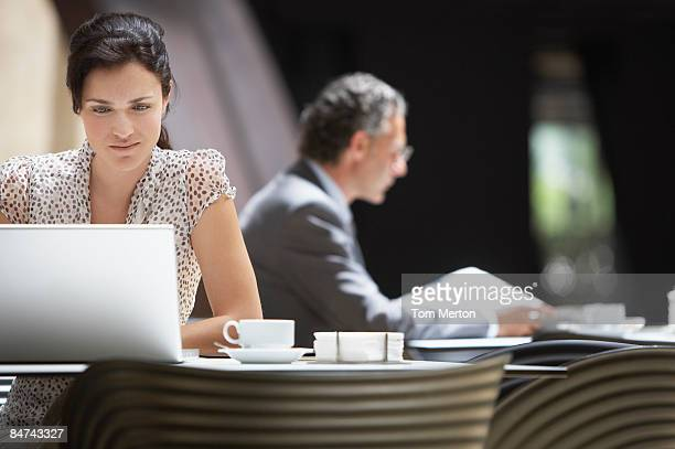 businesspeople in hotel cafe - hot desking stock pictures, royalty-free photos & images