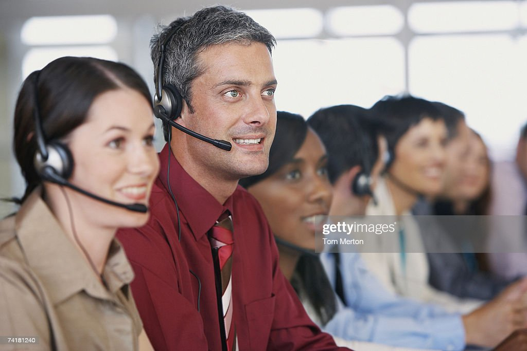 Businesspeople in meeting with translation : Stock Photo