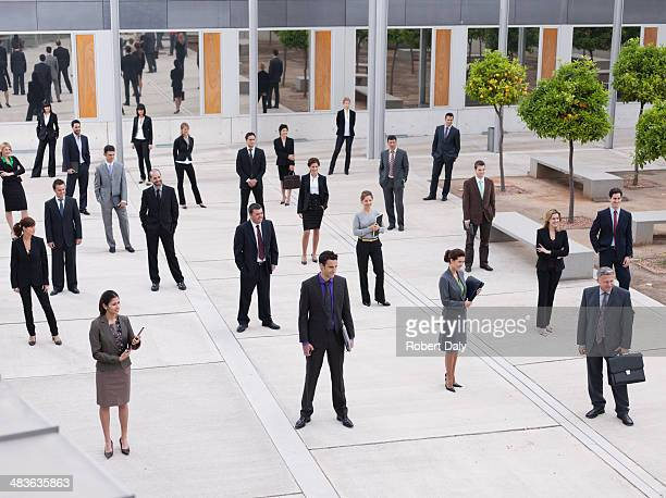 Businesspeople in modern office courtyard