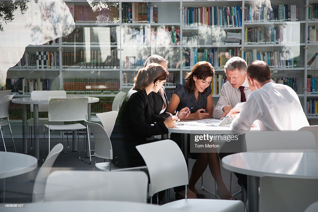 Businesspeople in office meeting : Stock Photo