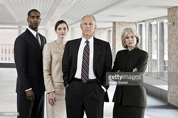 businesspeople in office - four people stock pictures, royalty-free photos & images
