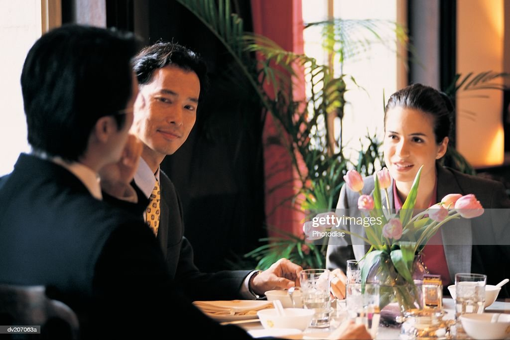 Businesspeople in restaurant : Stock Photo