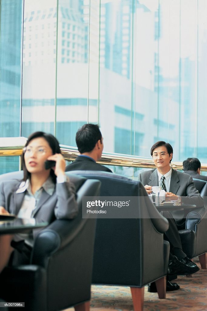 Businesspeople in restaurant : Stock Photo