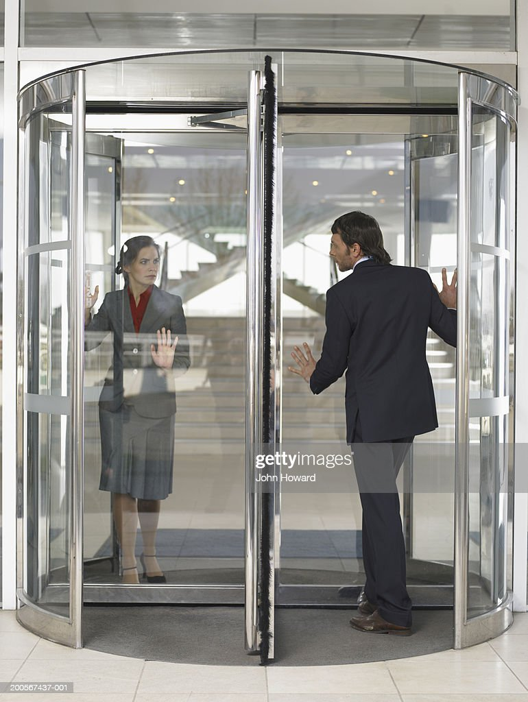 Businesspeople in revolving door & Revolving Door Stock Photos and Pictures | Getty Images