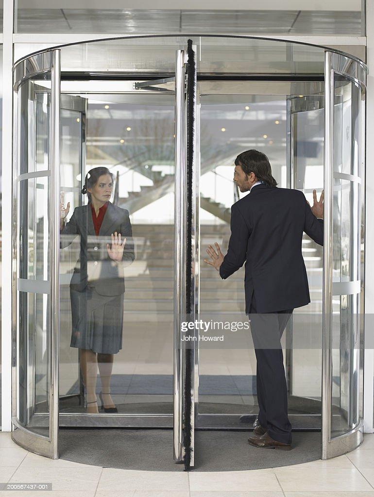 Businesspeople in revolving door & Revolving Door Stock Photos and Pictures | Getty Images pezcame.com