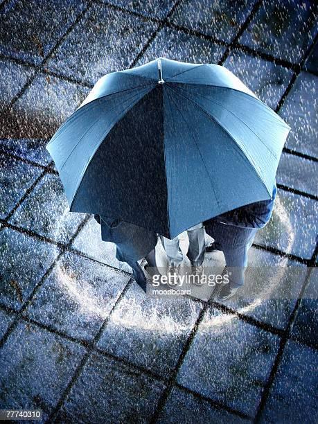 businesspeople in the rain - frau unter dusche stock-fotos und bilder