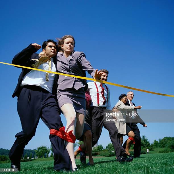 Businesspeople in Three-legged Race