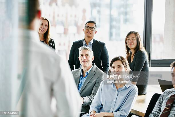 Businesspeople listening to project presentation