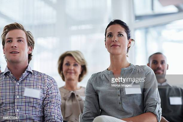 businesspeople listening to seminar - name tag stock photos and pictures