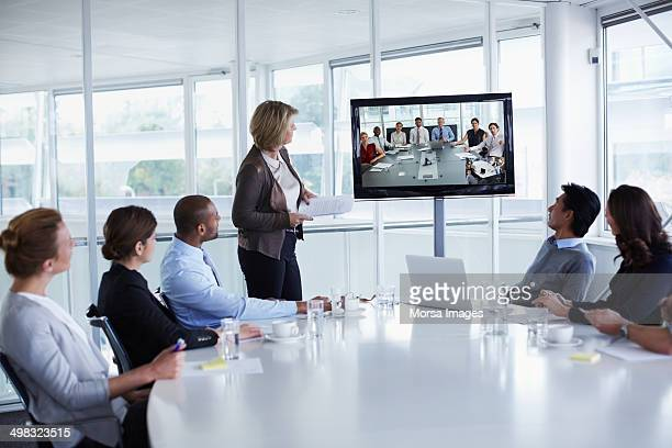 Businesspeople looking at screen