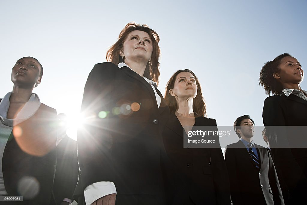 Businesspeople looking up : Stock Photo