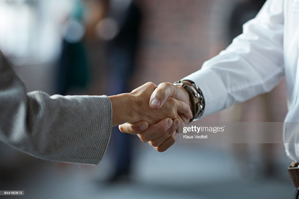 Businesspeople making handshake at conference : Stock Photo