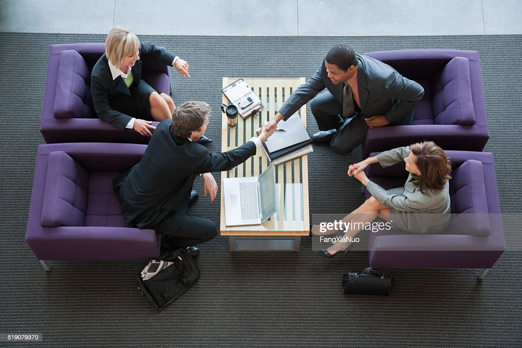 Businesspeople making introductions : Stock Photo