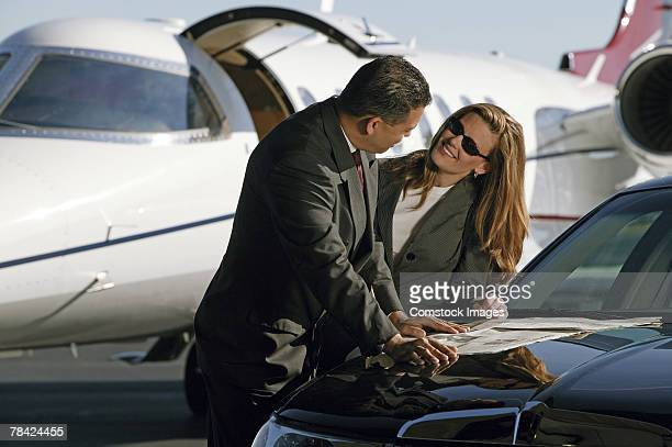 Businesspeople meeting by airplane