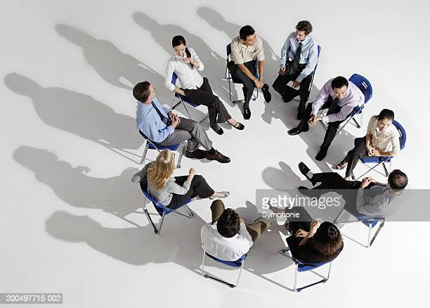 Businesspeople meeting in circle, elevated view