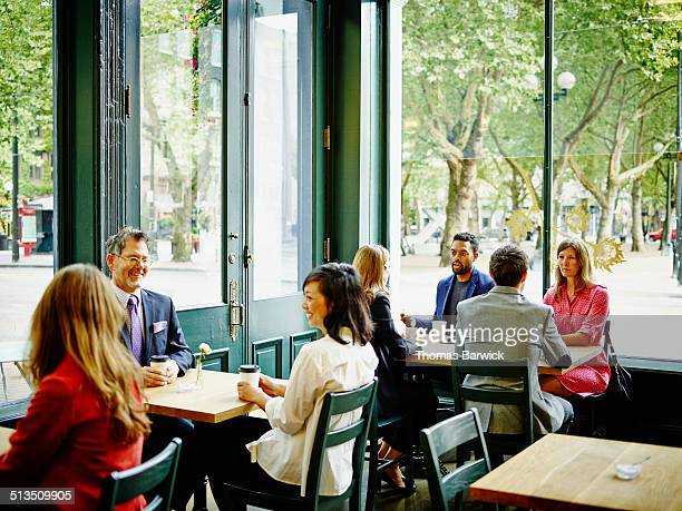 Businesspeople meeting in urban coffee shop