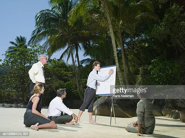 businesspeople meeting on beach - hans neleman ストックフォトと画像