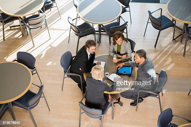 Businesspeople meeting over coffee