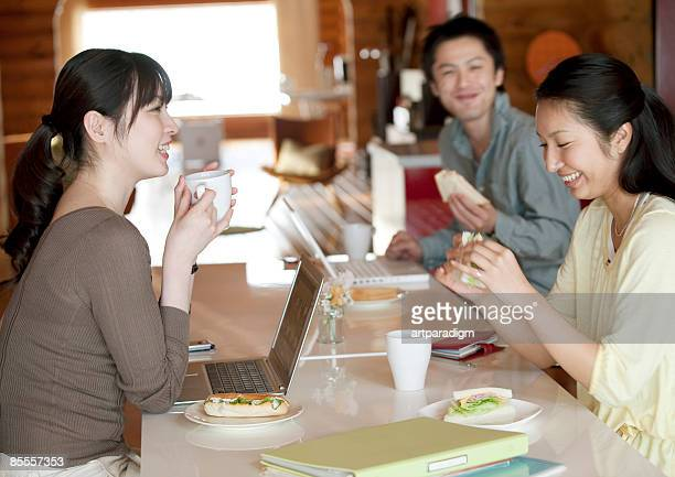 Businesspeople meeting over lunch in home office