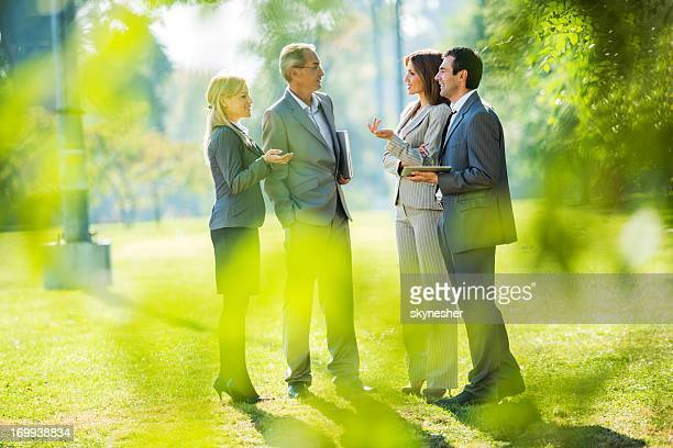 Businesspeople on a break outdoors.