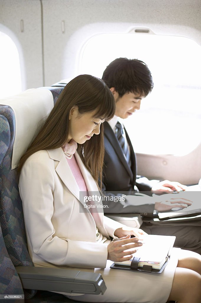 Businesspeople on a Plane : Stock Photo