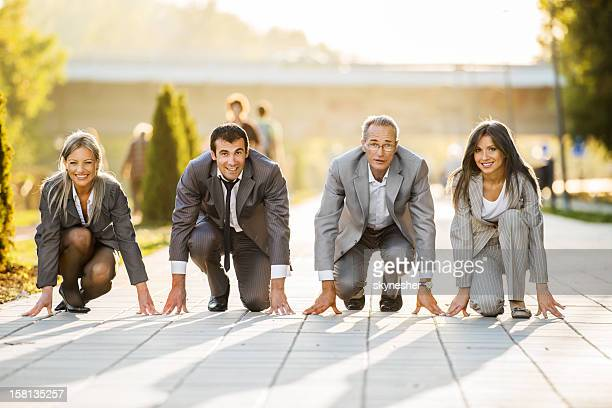 businesspeople on a starting line, ready to run - sportkleding stock pictures, royalty-free photos & images