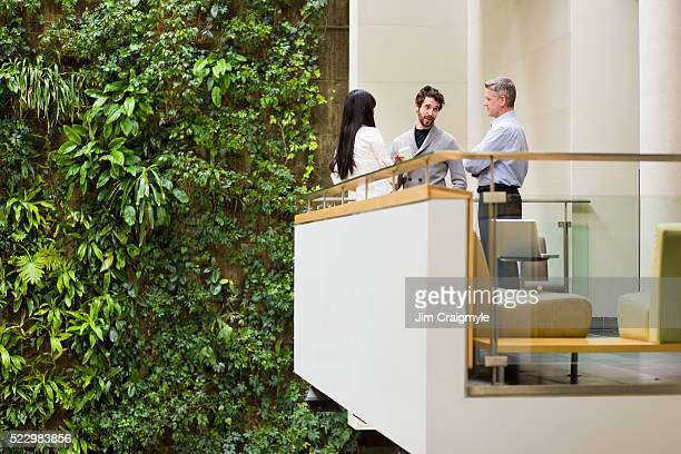 businesspeople on balcony - building atrium stock pictures, royalty-free photos & images
