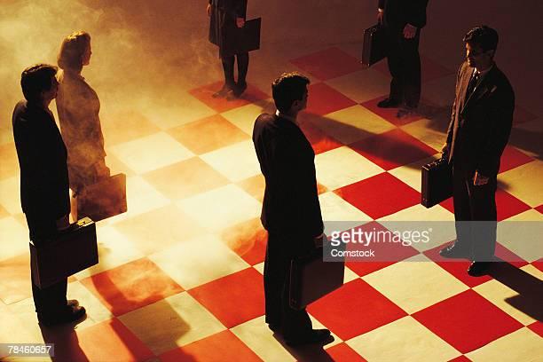 Businesspeople on chessboard
