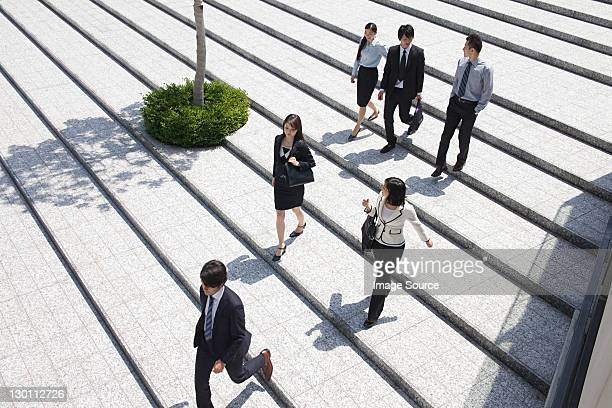 Businesspeople on steps, high angle
