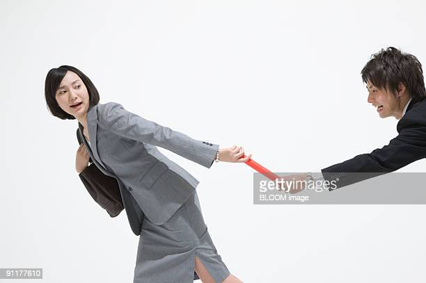 Businesspeople passing baton