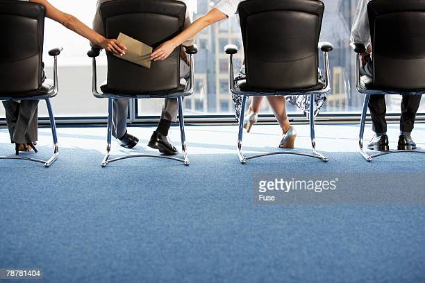 Businesspeople Passing Notes in a Meeting