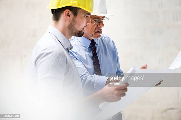 businesspeople planning construction - surveyor stock photos and pictures