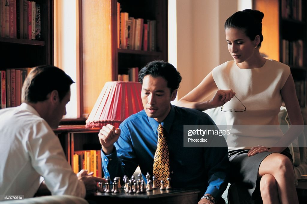 Businesspeople playing game of chess : Stock Photo