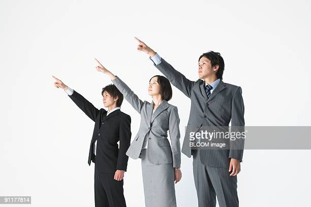 Businesspeople pointing upward