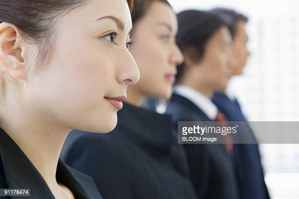 Businesspeople, portrait, close-up, side view