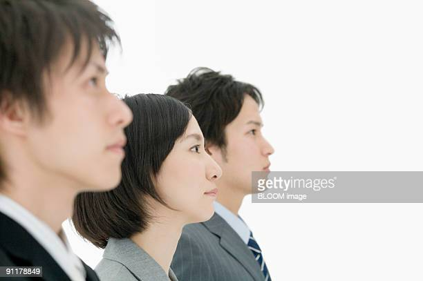 Businesspeople, portrait, side view