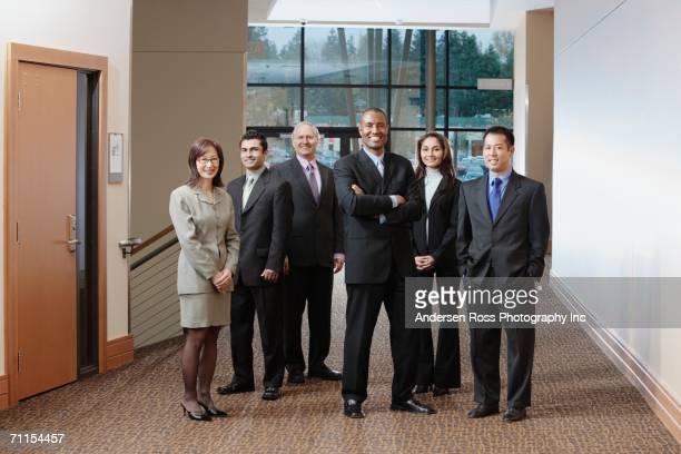 Businesspeople posing in hallway
