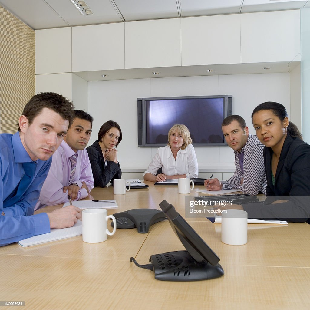 Businesspeople Sitting Around a Conference Table : Stock Photo