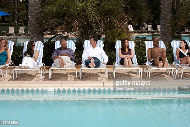 Businesspeople sitting at poolside