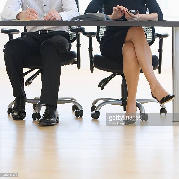 Businesspeople sitting at table