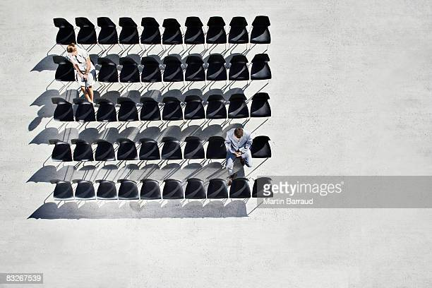 businesspeople sitting in office chairs on sidewalk - large group of objects stock pictures, royalty-free photos & images