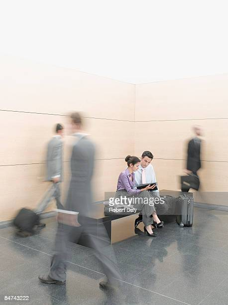 Businesspeople sitting on bench in lobby