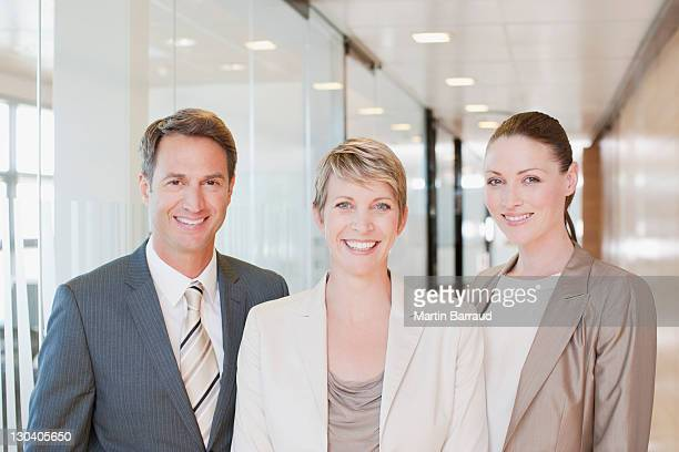 Businesspeople smiling in office