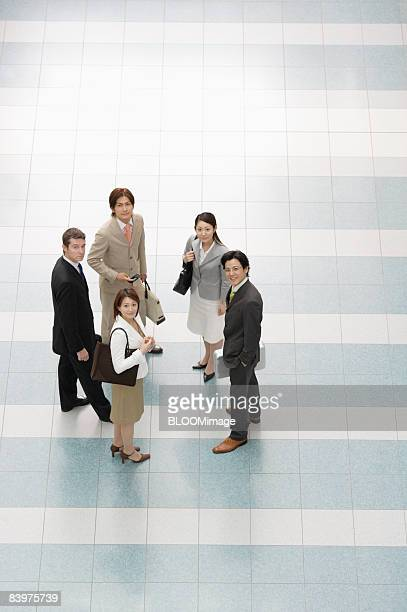 businesspeople standing in circle, looking at camera, view from above - 5人 ストックフォトと画像