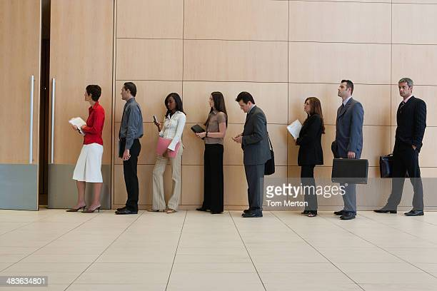 businesspeople standing in line  - lining up stock pictures, royalty-free photos & images
