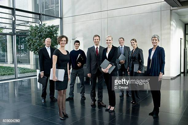Businesspeople standing in lobby