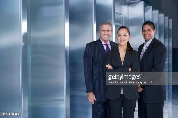 Businesspeople standing in office laptop